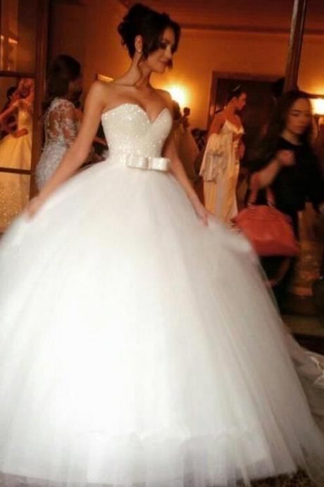 Beaded Embellished Sweetheart Floor Length Tulle Wedding Gown Featuring Bow Accent Belt